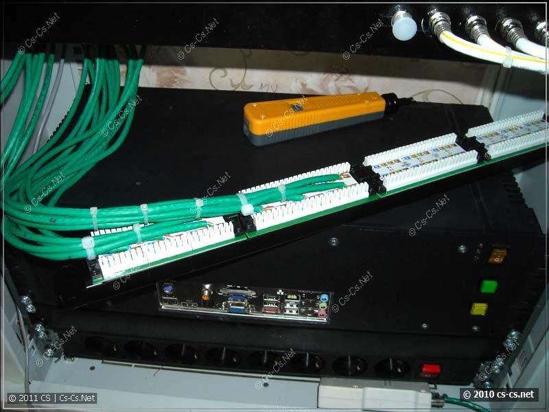Первая половиная патч-панели готова; кабели связаны в группы