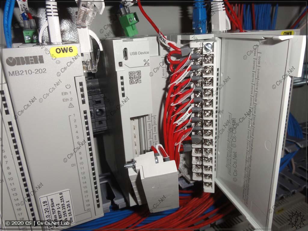 Процесс сборки щита на модулях ОВЕН Мх210: попытка снять один из модулей из щита
